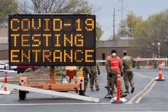 "The Indiana National Guard 163rd Field Artillery unit assists with traffic at the free COVID-19 testing site for ""essential"" in the parking of the C.K. Newsome Center in Evansville, Ind., Monday morning, April 13, 2020. The testing is meant for first responders, health care workers, grocery employees and others meeting the ""essential"" definition and will continue from 9 a.m. to 6 p.m. every day through Friday."