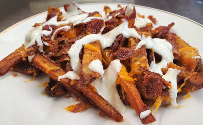 Loaded steak fries with cheese, bacon and ranch from the Route 62 Diner in Chandler.