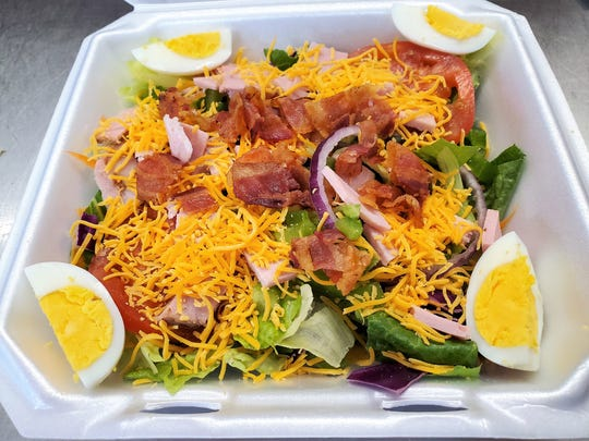 A chef salad topped with eggs, ham, bacon and cheese from the Route 62 Diner in Chandler.