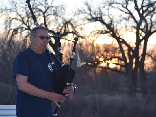 Mike West plays the bagpipes at sunset April 6, 2020, along the Poudre Trail in Windsor. The fire chief at Front Range Fire Rescue is a member of the Colorado Emerald Society, a 75-member band of police officers and firefighters. West and other band members play evenings near sunset to provide relief from those suffering the coronavirus blues.