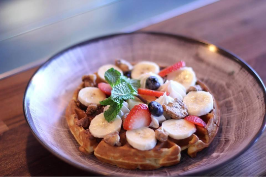 "Chef Ben Voisin of Gather and Fathoms restaurants in Cape Coral tops his waffles with fresh fruit, maple syrup, Nutella or ""anything you like, really."""