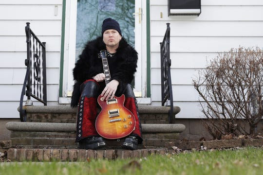 Paul Hanna of Green Bay rock band Annex sits outside his Allouez house on April 9. With venues closed because of the coronavirus pandemic, Hanna started live streaming shows three times a week on Facebook.