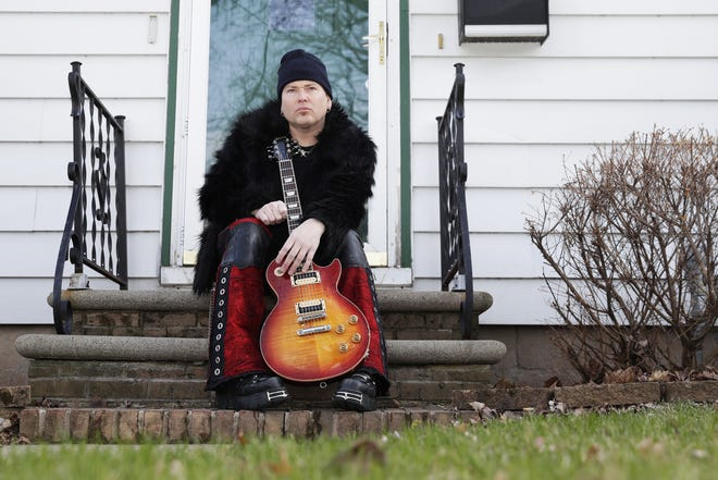 Paul Hanna of Green Bay rock band Annex sits outside his Allouez house on April 9, 2020. With venues closed because of the coronavirus pandemic, Hanna started live streaming shows three times a week on Facebook.