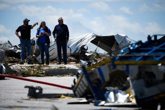 BorgWarner Inc. employees assess the damage done to their manufacturing plant in Seneca after a tornado hit the area early Monday, April 13, 2020.