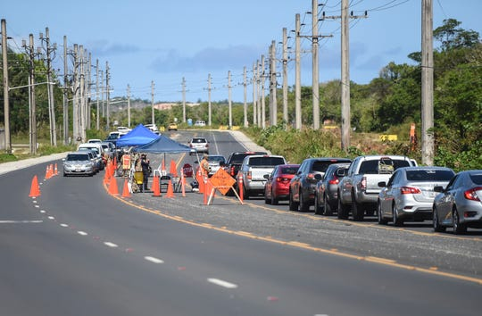 A road closure in Dededo creates long lines of traffic on Route 1, April 13, 2020.
