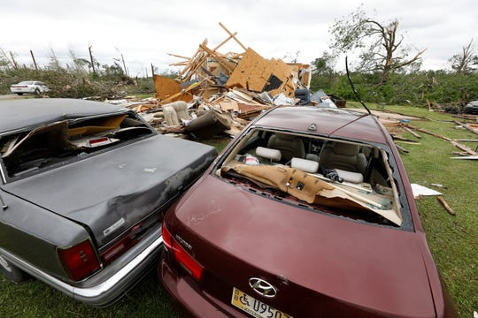 Two cars were slammed into each other by a tornado that tore through this Bassfield, Miss., neighborhood, Monday, April 13, 2020. Severe weather has swept across the South, killing multiple people and damaging hundreds of homes from Louisiana into the Appalachian Mountains. Many people spent part of the night early Monday sheltering in basements, closets and bathroom tubs as sirens wailed to warn of possible tornadoes.