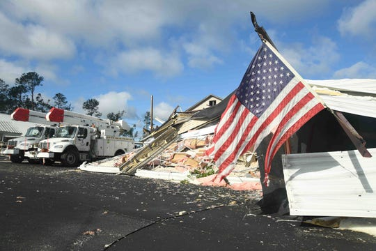 A tattered American flag hangs on the partially destroyed former Soso Elementary School building after a tornado touched down Easter Sunday, April 12, 2020.