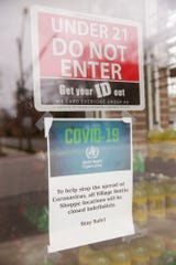 A sign posted on Village Bottle Shoppe #1, 302 Vine St., advises of the stores temporary closure due to the Coronavirus pandemic, Monday, April 13, 2020 in West Lafayette.