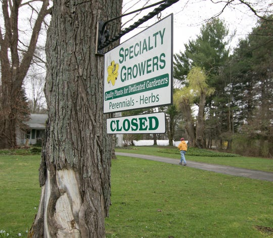 Specialty Growers in Genoa Township, shown Monday, April 13, 2020, relies on spring sales, according to owner Karen Bovio, who hopes the ban on sales is lifted soon.