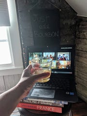Courier Journal columnist Dana McMahan does a virtual toast with friends during a recent bourbon tasting.