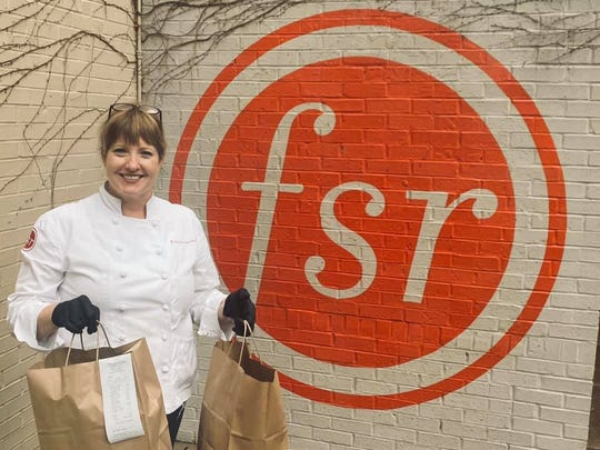 Felicia Willett delivers curbside takeout at her downtown restaurant Felicia Suzanne's.