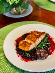 Takeout at home! Grilled salmon over black Thai rice with wilted spinach and beet sauce from Napa Cafe. Tip: Plate your takeout like you think the restaurant would!
