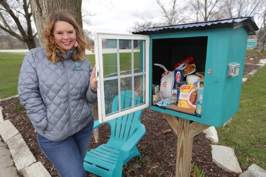 Books in a Little Free Library have been replaced by snacks, food and paper products in front of the home of Heather Nelson in Pewaukee.
