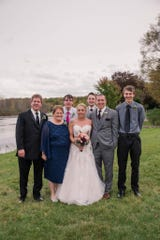 Tonia Hetzel, second from left, stands with her family, from left, husband Kevin, son Bailey, daughter Brianna, son Christopher, son-in-law Nick, and son Devin at her daughter's wedding in October 2019.