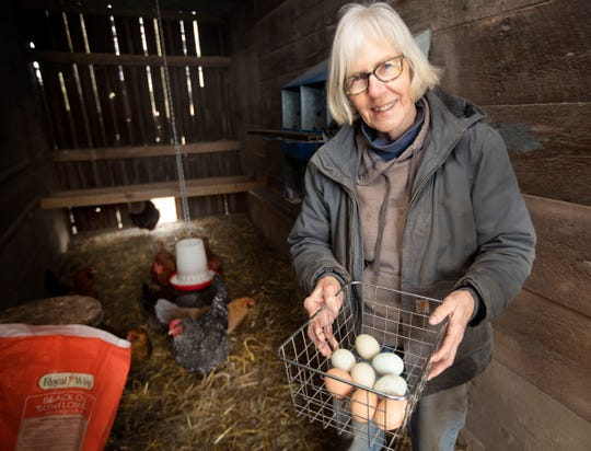 Betty Adelman holds eggs she collected from her laying hens Monday March 30, 2020 at her home in Mukwonago.