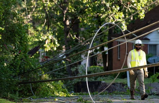 Alabama Power workers repair power lines damaged by the overnight storms in the Capitol Heights neighborhood in Montgomery, Ala., on Monday April 13, 2020.