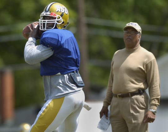 Alabama State University head football coach Charlie Coe watches quarterback Tarvaris Jackson during spring practice on the ASU campus in Montgomery, Ala. on Tuesday April 12, 2005. (Montgomery Advertiser, Mickey Welsh)
