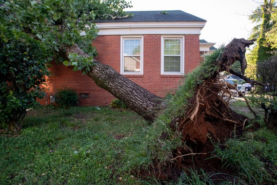 A tree on a house in the Capitol Heights neighborhood in Montgomery, Ala., after overnight storms on Monday April 13, 2020.