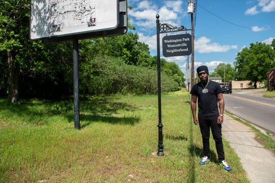 Montgomery Rapper Rockstar JT poses for a portrait in the Washington Park neighborhood in Montgomery, Ala., on Monday, April 13, 2020. JT signed with RMG Amplify.