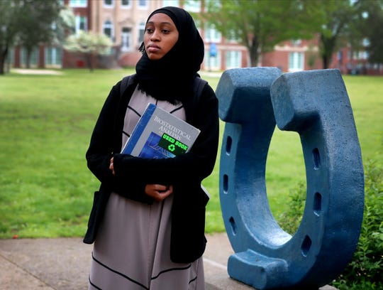Daiche Issa, an MTSU Biology student from the United Arab Emirates, poses next to the Blue Horseshoe on the university's campus. Issa was one of dozens of students who remained in campus housing as COVID-19 restrictions did not permit her to travel home.