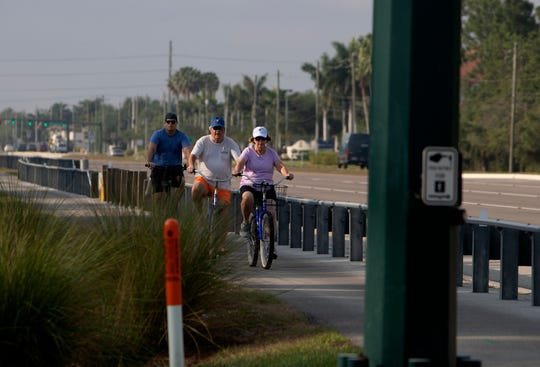 A group of bike riders ride their bikes along Airport-Pulling Road in North Naples on Friday, April 10, 2020.