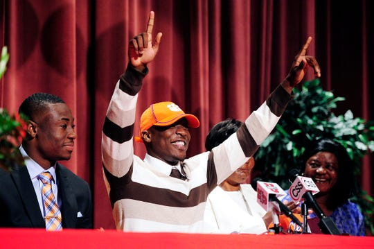 Immokalee's Mackensie Alexander surprises the crowd with his decision to go to Clemson during a National Signing Day ceremony in 2013.