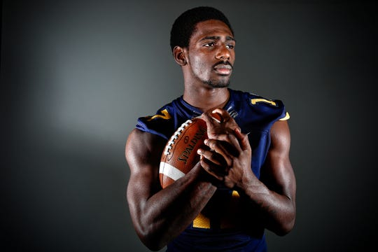 Naples High School's Tyler Byrd during a photo shoot for winning the 2015 Broxson Trophy Award as a senior