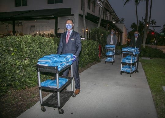 Sails Restaurant in Naples teamed with William Raveis Real Estate to deliver 150 meals Friday, April 10 to healthcare workers at NCH Baker Hospital. The businesses plan to donate meals to every department battling the COVID-19 pandemic.