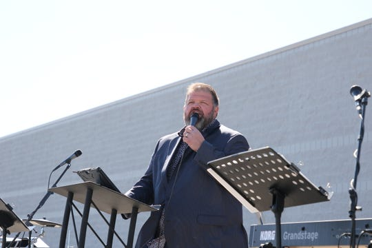 Ronnie Williams, pastor of Harvest Fellowship in Artesia, leads Easter services April 12, 2020. The church hosted a drive-in service.