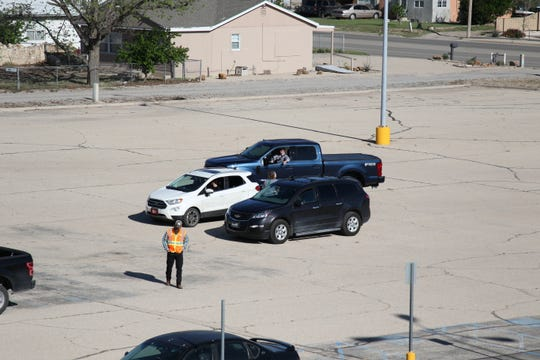 Vehicles started pulling into the parking lot of Harvest Fellowship in Artesia at 9 a.m. April 12, 2020. The church hosted a drive-in Easter service.
