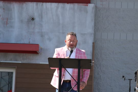 Jerry Jamieson, youth pastor at Harvest Fellowship in Artesia, leads singing during an Easter drive-in service on April 12, 2020.