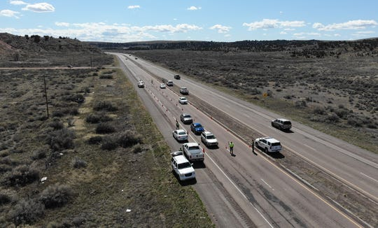 A drone photo shows a checkpoint by the Navajo Police Department on New Mexico Highway 264 in Tsé Bonito. The Navajo Nation completed a 57-hour curfew at 5 a.m. on April 13.
