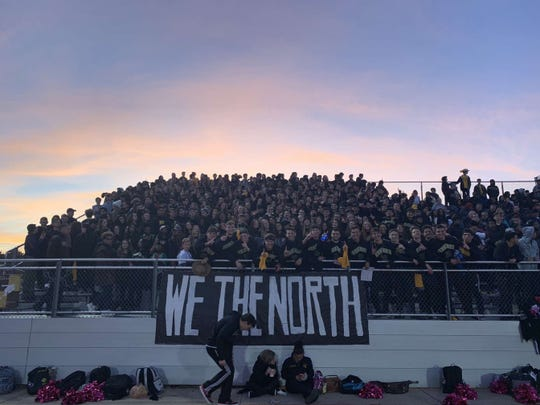 Wes Miller, in the middle front, poses with the North Farmington student section at a football game.