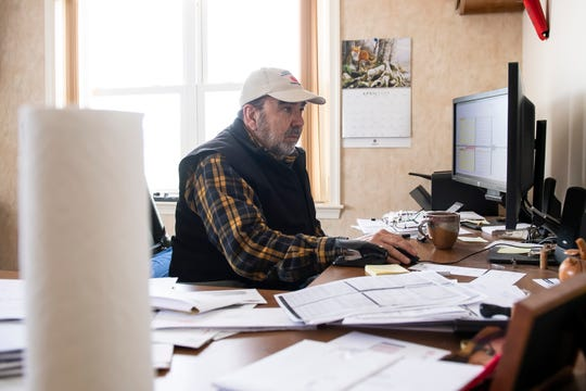 Chris Baugher works in his office at Adams County Nursery in Aspers on Friday, April 10, 2020. Baugher is a co-owner and vice president of fruit production at the more than 110-year-old family business.