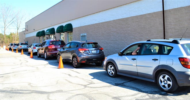 Cars line up to receive free community meals at Bistro 163 on April 8. The Bistro serves about 320 meals four nights a week.