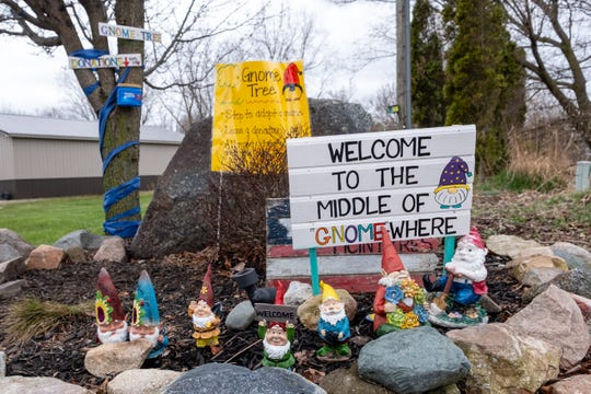 "A Melvin family has been making gnomes and hanging them in a tree at the end of their driveway. The gnomes are ""adoptable"" for a donation, and funds raised will be given to the Yale Community Food Fund."