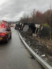 A tractor-trailer crashed on Interstate 84 while driving amid high wind speeds as seen on Monday, April 13, 2020.