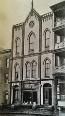 1903 photograph shows the building with a retail establishment on the first floor.
