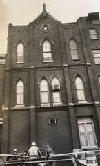 1983 photograph shows the building was restored to its early 1900s appearance.