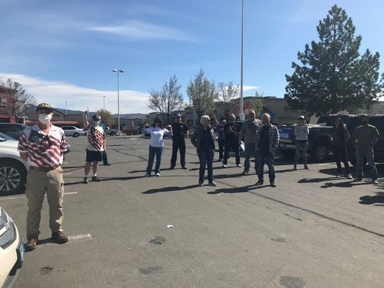 A group of protesters is pictured on Easter, April 12, 2020, at the Damonte Ranch Parkway Walmart in Reno.