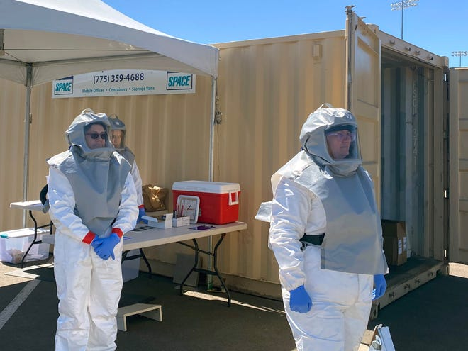 Nurses from the Washoe County Health District during a mock COVID-19 swabbing at the Reno-Sparks Livestock Events Center on Monday, April 13.
