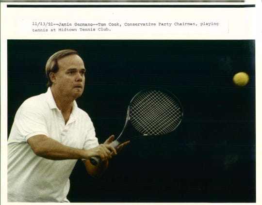 Cook, Thomas D.  Conservative Party Chairman, playing tennis at Midtown Tennis Club.