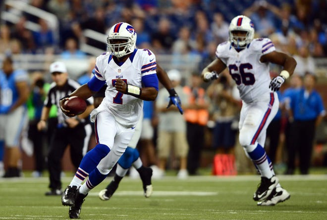Buffalo Bills quarterback Tarvaris Jackson (7) scrambles out of the pocket in the fourth quarter against the Detroit Lions in a preseason game at Ford Field on Aug. 30, 2012. Jackson died in a car crash in Alabama on April 12, 2020.