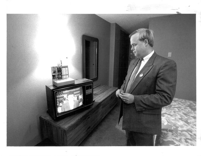 Thomas Cook, in a past Democrat and Chronicle article, watching election results.