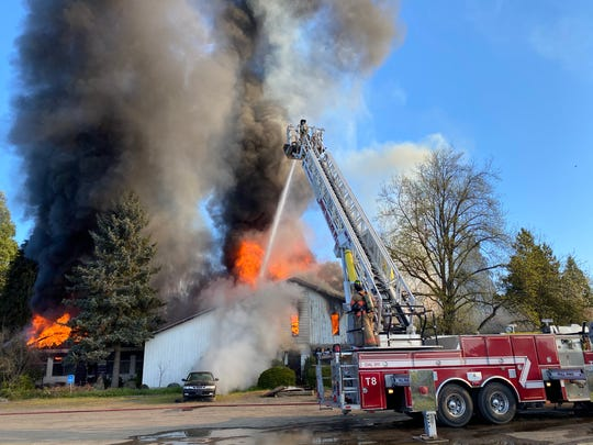 Crews battled a two-alarmfire Monday morning in Sheridan, but were unable to salvage the structure from collapsing.