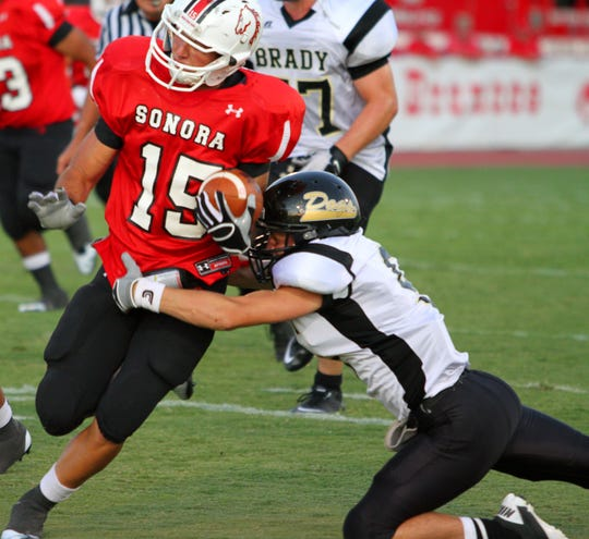 Sonora wide receiver Word Hudson breaks a tackle for a big gain against Brady on Aug. 26, 2011.