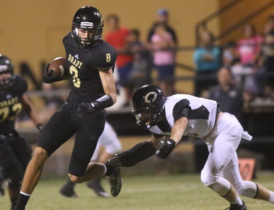 Brady High School's B.J. Hollis eludes a Clyde defender en route to a long reception gain during a 2014 game.