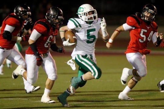 Wall High School's Grant Eubank runs the ball 90 yards through the Eastland defense en route to a touchdown in their regional final playoff game Dec. 7, 2012.