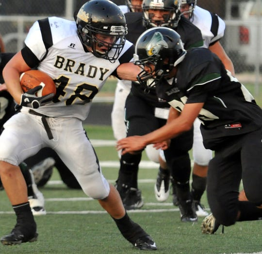 Jacob Hodges battles for yardage in a 2011 game against Grape Creek.