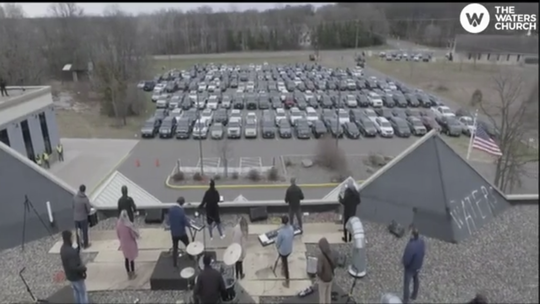 A drone captured the overall scene of The Waters Church Easter Sunday services as cars were parked in the parking lot listening to worship on Sunday, April 12, 2020, at The Waters Church in Sartell.